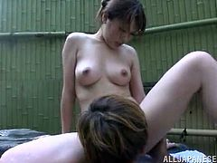 Hot Japanese bitch is playing dirty games with some dude in an outdoor pool. They kiss and caress each other and then the chick gets her snatch pounded deep and hard from behind.