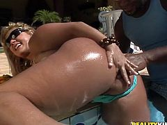 Insatiable black daddy finger fucks gaped shaved cunt of flamboyant white mom that stands in doggy pose before he approaches her from behind for a hard fuck from behind in sultry interracial sex video by Reality Kings.