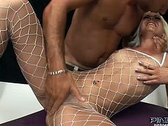 This beautiful blondie in fishnets is enjoying her dildo at first but then she gets a meaty cock to sit on.
