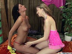 Svelte brunette fairy drills unused shaved vagina of another cutie with dildo while polishing her clit before the former stands in doggy pose to welcome a tongue fuck of her tasty pussy in steamy lesbian sex video by Club Seventeen.
