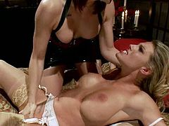 This horny blonde girl has her first femdom experience in the video. She gets dominated by Charisma Cappelli. Chanel gets tied up and fucked with a strap-on.