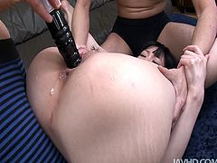 Playful Japanese sweety with lovely face and slim body looks really hot in this awesome threesome video. She lets two horny guys play with her pussy shoving dildo toy deep in her slit. Later she provides them with handjob.