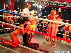 Horny bitches go madly exciting watching brutal dudes fighting on a ring. So when the fight ends they all join these men on a stage going kinky and wild.