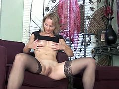 See the hot blonde milf Trinity playing with her shave slit while assuming very naughty poses. She looks hot in those black stockings.