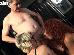 What a hot and hardcore fetish scene this is. This dude tortures two grannies and makes them play with his dick.