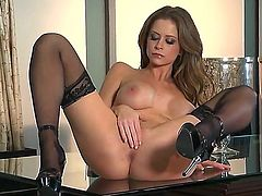 Elegant and hot bombshell Emily Addison rubs her pussy with a beautiful smile on the face