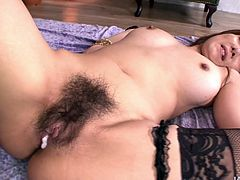 Two horny Asian men drill bushy cunt of Yuna Hirose. They fuck her missionary style and feed her with small cock at the same time.