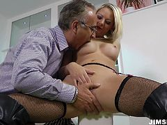 She is raunchy blonde mom wearing fishnet stockings and leather jackboots. She rides the hard dong and later gets rammed hard doggy style. After, she gives a hot deepthroat blowjob.