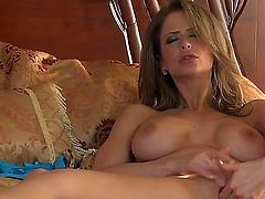 Heavy chested glamorous brunette Emily Addison with heavy make up and gigantic firm hooters in high heels only fingers her wet honey pot to orgasm in amazing solo action.
