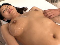 Oil covered cutie from Japan is already naked. Her body is oil covered. Kinky chick plays with her tits and lies onto the bench for getting erotic massage. Slim nympho stretches legs wide, opens her hairy pussy and hopes to get it teased also.