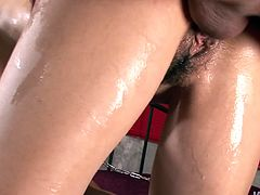 Mesmerizing Japanese fairy with exotic face stands on her knees while giving double blowjob to two sturdy cocks before she stands in doggy pose to get fucked hard from behind in sultry threesome sex video by Jav HD.