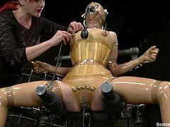 Girl in latex gets some pain in an arched pose