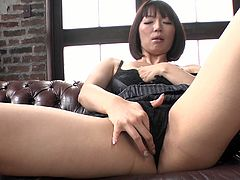 Curvy Japanese milf in steamy black lingerie sticks her hand under panties to rub shaved cunt rapaciously before she takes vibrating egg to continue teasing her cunt.