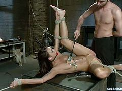 Cute brunette Katie Jordin is having fun with James Deen indoors. James immobilizes Katie and pleases her with toying nad pounding.