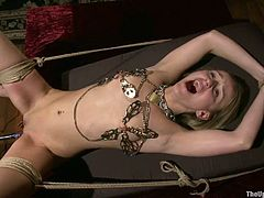 A vibe is crushed against this blonde slave's tight pussy. Then she gets tied up and impaled by a red dildo over and over till their masters untie her and bang her.