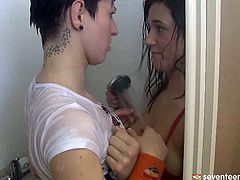 Two luscious babes play steamy lesbian games in shower. They arouse each other's pussies with water strain before they start mauling cuddly tits.