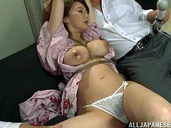 Busty Japanese mom Mio Takahashi wearing a kimono is having fun with two dudes. The men bind her and pull her by the nipples and then fuck her hot mouth deep and hard.