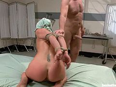 Lovely Sheena Shaw gives a blowjob to the doctor. After that she gets undressed and tied up. Later on she gets toyed, fingered and fucked.