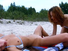Being along at the beach, hotties are getting horny and eager to play with one another's pussy