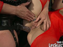 Steamy BDSM-involved sex session featuring two hot lesbians