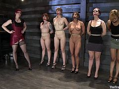 All five girls are amazing. They get tied up by redhead chick and humiliated. Some of these girls get toyed with a vibrator as well.