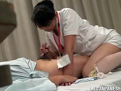 Slutty Japanese nurse gets seduced by one of her patients. She lets the dude play with her cunt and then they have sex in cowgirl and missionary positions.