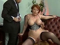 Sexy mature lady fucked by two guys