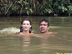 Aroused wanker cannot take his hands and mouth off a frisky Latin milf with curvy frame while they swim in a pond. He rubs her juicy ass while giving her an erotic massage.