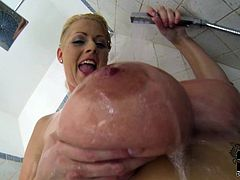 Dirty blonde amazes with her huge tits and naughty cunt during shower solo session