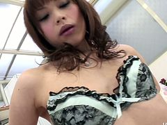 Luscious Japanese babe in steamy lingerie eats strawberry with her sweet mouth before she spreads her legs to rub unused pinkish vagina with manicured fingers.