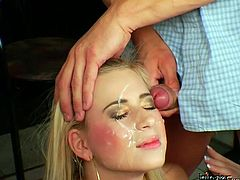 Aroused dudes spray pretty face of filthy blondie with hot cum after jerking off