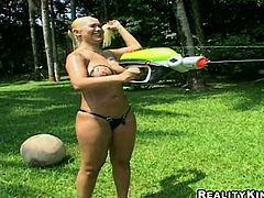 Two hot Latina brunette and blondie are already naked in the yard. Torrid chick weigh their boobs to find out whose are the biggest. Then ardent nymphos provide each other with erotic massage on the deckchair.