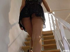 She is dazzling tall model with killer body. She agrees to do porn vid with old geezer so she goes indoor with him. She places on stairs playing with her pussy teasing him.