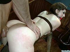 Beautiful brunette Jennifer White is having fun with James Deen in a basement. James puts Jenny into fetters and fucks her ass with a dildo before destroying it with his dick.