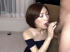 Classy looking MILF actress wears romantic black dress giving a short interview. Then she is offered to suck a dripping cock. She takes it in her pretty mouth with pleasure.