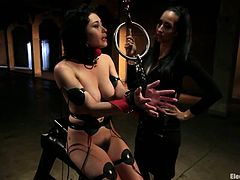 Isis Love and Raven Rockette are having fun in a dark room. Isis binds Raven, strokes her beautiful body and then rubs her delicious pussy with a dildo.