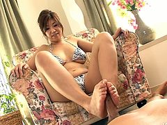 Professional Asian hoe Naho Hadsuki gives titjob and handjob