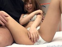 Adorable Japanese girl takes her clothes off and shows her slim body to some guy. The dude rubs the chick's vag with a dildo and then fucks it doggy style and in other positions.