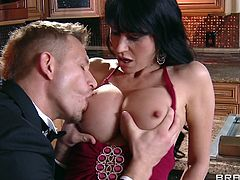 Eva is a one brunette milf who loves to play dirty. Her appealing body taunts that big dick guy and he is taking her to the kitchen. Then he gropes her juicy boobs and making her moan. She repays him by going down and she is wrapping her lips around that cock after he gave her a throat fuck.
