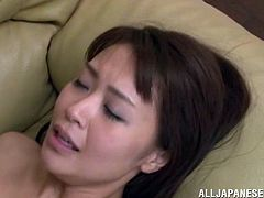 Adorable Japanese girl undresses and gets her vagina fingered. After that she gets fucked nice and deep in a living room.