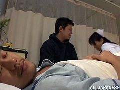 Salacious Japanese nurse is having fun with two dudes in a hospital ward. She sucks their cocks hungrily and then gets her wet coochie pounded deep and hard.