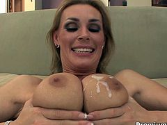 She is mind-blowing blonde mom with big boobs. She seduces young stud and fucks him passionately. She is happy when she gets her tits glazed with cream.