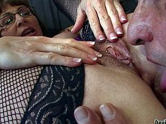 Alexandra Silk is a four-eyed mature brunette in mesh stockings. Bushy woman spreads her legs wide and spreads her hairy pussy lips to let man lick her pierced clit. She shows it all and gets some pleasure.