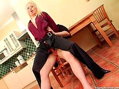 Sextractive blond milf lies on a kitchen table with her legs spread aside to allow her horny hubby pound her hairy soaking pussy through a hole in pants. Later she gets on his sturdy penis for a ride in reverse cowgirl style.