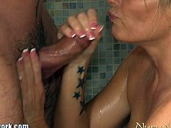 This blonde milf with big tits spoils this guy with a sloppy blowjob, a bath and a full body nuru massage.