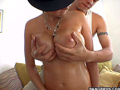 Curvy pornstar Gianna Michaels in black hat shows off her sexy nude body with no shame. She demonstrates her gigantic natural boobs and bubble butt. Man is free to touch her sexy huge melons.