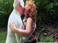 This horny couple have been married for years but they still like to get their fuck on!  Busty Daniela has got a pair of boobs to die for - if you love sagging mature knockers then you will definitely dig this redhead babe!  Her man, although eager in spirit, is lacking in the flesh, and although he can still get rock hard he lets his wife do most of the work.  After giving her a brief doggystyle pumping behind a bush he lets her finish off, first by riding his dick and then jerking him off the rest of the way.  Daniela is a horny sexpot, cumming multiple times on the prick and then masturbati