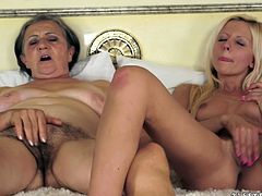 Lewd granny Kata is having fun with pretty blonde Summer indoors. The women lick each other's pussies and then finger them till they get an orgasm.