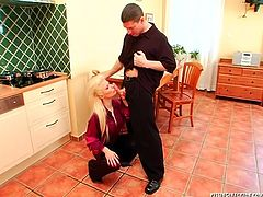 Perverse dude pisses in a bowl while his sextractive blond wifey cooks a dinner on kitchen. Later she kneels down to give him a deepthroat blowjob before he takes her from behind in doggy style as she bends over a table.