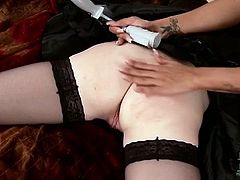 Perverse domina in latex costume crucifies innocent maid before she starts licking her pinkish nipples zealously and stroking her ruined pussy with vibrator.
